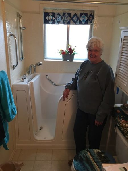 Happy customer with her new walk in bathtub (1)