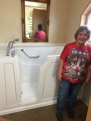 Happy customer next to her new walk in bathtub (2)